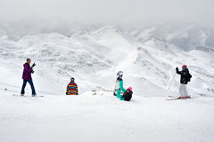 Happy snowboarders and skiers enjoy on top of mountain Royalty Free Stock Photography