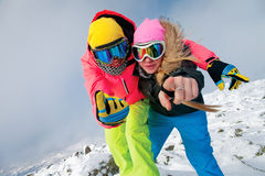 Happy snowboarders Royalty Free Stock Photo