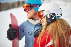 Happy snowboarders Royalty Free Stock Images
