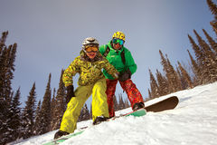 Happy Snowboarding Couple Stock Image