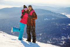 Happy snowboarding couple Stock Images