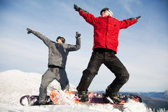 Happy snowboarding team Stock Image