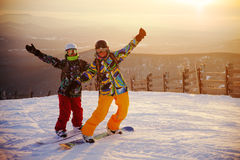 Happy snowboarding team Royalty Free Stock Image