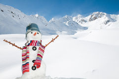Happy snowman. On mountais - space for text Stock Images
