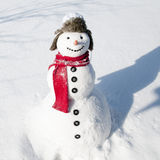 Happy snowman. In deep snow Royalty Free Stock Image