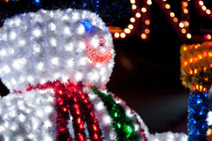 Happy Snowman. Expression of Happiness and Joy of illuminated snowman for Christmas Stock Images