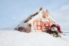 Happy snowman and cookies house Royalty Free Stock Photography