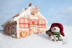 Happy snowman and cookies house Stock Image
