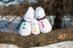 Happy Snowman Family. Hand-made snowmen on a log Royalty Free Stock Images