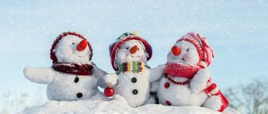 Happy snowman family. With hats n the snow Royalty Free Stock Photo