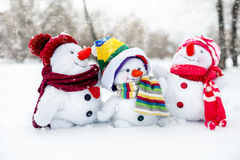 Happy snowman family Stock Photos
