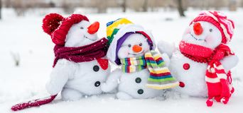 Happy snowman family. With hats n the snow Stock Image