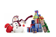 Happy snowman with gifts. Happy snowman with hat, scarf and christmas gifts Royalty Free Stock Photography