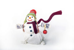 Happy snowman with gifts. Happy snowman with hat, scarf and christmas gifts Royalty Free Stock Photos