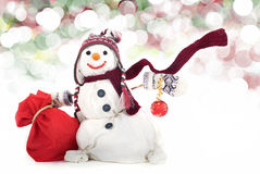 Happy snowman with gifts. Happy snowman with hat, scarf and christmas gifts Stock Image