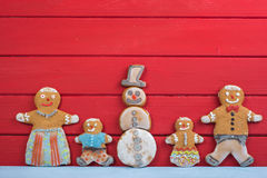 Happy Snowman and gingerbread man family Stock Photography