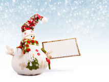Happy snowman with greeting postcard Royalty Free Stock Photography