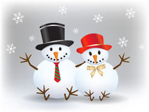 Happy snowman with his snow lady with snowflakes on christmas Royalty Free Stock Photo
