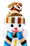 Happy snowman in knitted hat and scarf isolated on white background Stock Photos