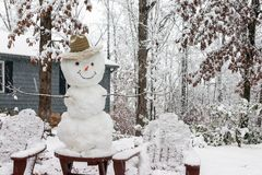 Happy snowman in a rare Georgia snowstorm in December. royalty free stock image