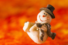 Happy snowman on red background. Happy snowman with hat and gloves on red background Stock Photos