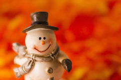 Happy snowman on red background. Happy snowman with hat and gloves on red background Royalty Free Stock Photos