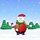 Happy Snowman in red with christmans tree and snow on back Royalty Free Stock Image