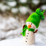 Happy snowman on snow Stock Images