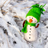 Happy snowman on snow Stock Photo
