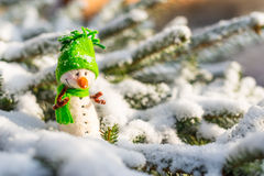 Happy snowman on snow Royalty Free Stock Photography