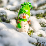 Happy snowman on snow Royalty Free Stock Images