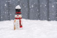 Happy snowman standing in christmas landscape with copy-space an stock photos