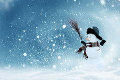 Happy snowman standing in christmas landscape Royalty Free Stock Photo