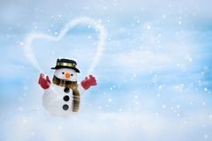 Happy snowman is standing in winter christmas landscape stock photos