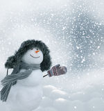 Happy snowman standing in winter christmas landscape Royalty Free Stock Photos