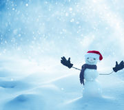 Happy snowman standing in winter christmas landscape Royalty Free Stock Images