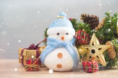 Happy snowman standing in winter christmas snow background. Merry christmas and happy new year greeting card with copy space. stock images
