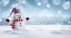 Happy snowman in winter secenery stock images