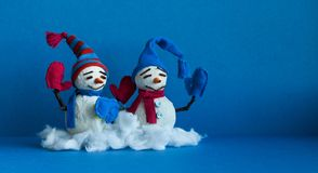 Happy snowmen on blue background. Winter traditional snowman characters with scarf mittens and funny hats. Xmas new year. Holidays greeting card royalty free stock image