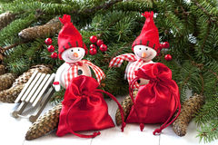 Happy snowmen with christmas decoration Royalty Free Stock Photos