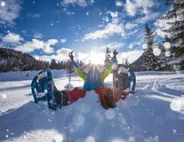 Happy snowshoe walker in powder snow with beautiful sun rays. Outdoor winter activity and healthy lifestyle Stock Images