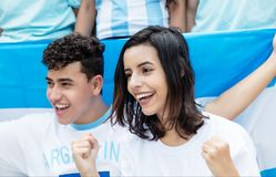 Happy soccer fans from Argentina with argentinian flag stock photo