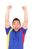 Happy soccer football fan watching game. Holding fist up celebrating isolated on white Stock Images
