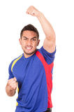 Happy soccer football fan watching game. Holding fist up celebrating isolated on white Royalty Free Stock Photography