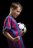 Happy soccer kid on black Stock Images