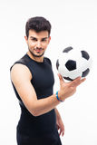 Happy soccer player holding ball Stock Images