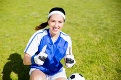 Happy soccer player showing her thumbs up Stock Photos