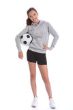 Happy soccer player teenage girl with sports ball. Tall slim soccer player teenage girl with happy smile wearing sports clothes, standing in casual pose with Stock Image