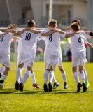 Happy Soccer Players. Happy Boys Winning Soccer Match. Young Successful Soccer Football Players Dancing Together Stock Photo