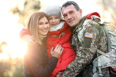 Happy soldier with family. In park stock image
